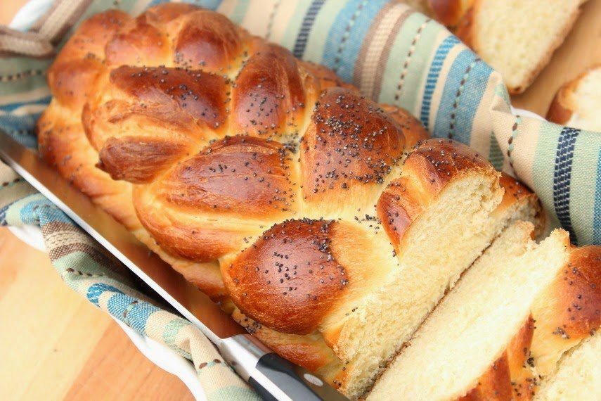 Braided Challah Bread in a basket with a knife.