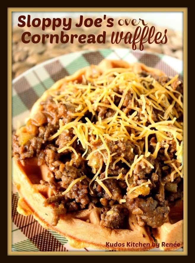 Sloppy Joes Over Cornbread Waffles with shredded cheese - kudoskitchenbyrenee.com