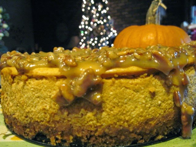 Maple Pumpkin Cheesecake with pecan caramel sauce
