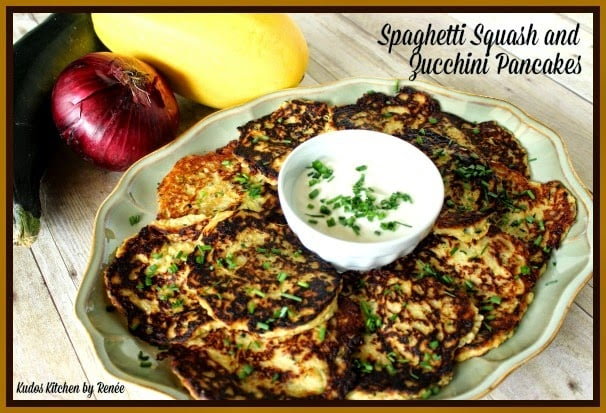 Spaghetti Squash and Zucchini Pancakes are savory and delicious. Serve with Greek yogurt and chopped chives.