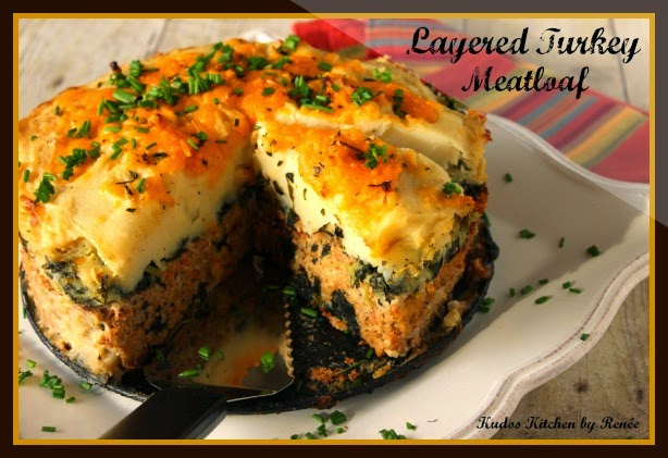 Layered Turkey Meatloaf baked in a spring form pan.