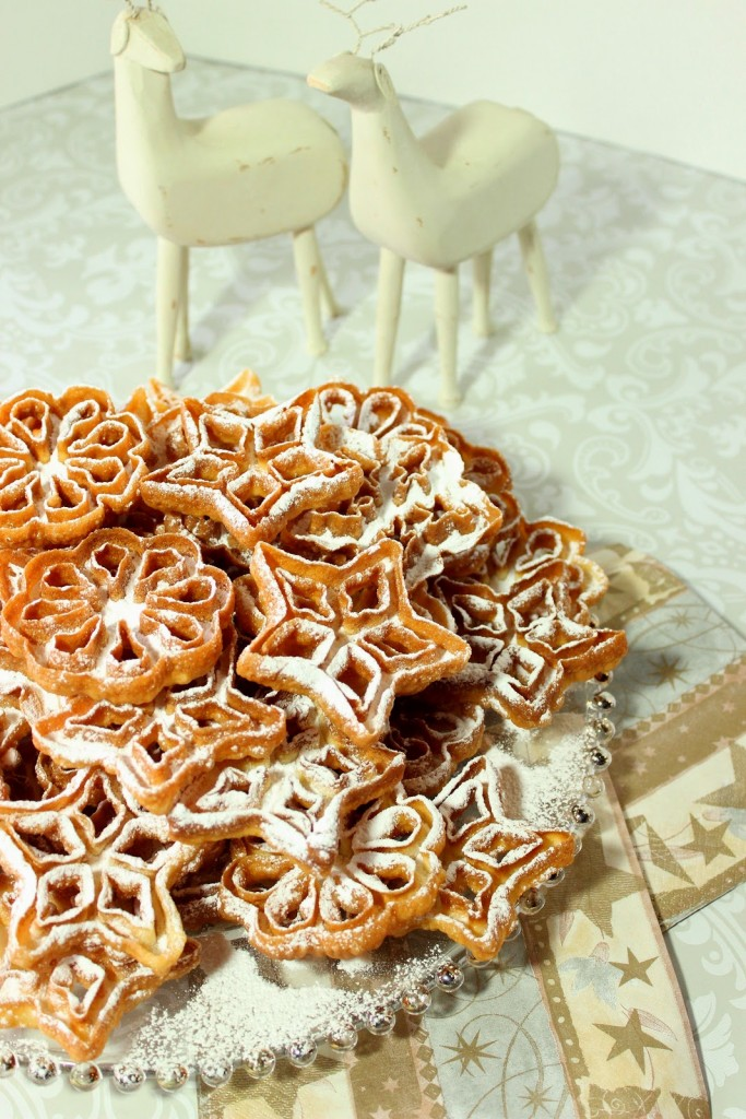 Fried Snowflake Rosette Cookies with Confectioners Sugar Dusting - kudoskitchenbyrenee.com