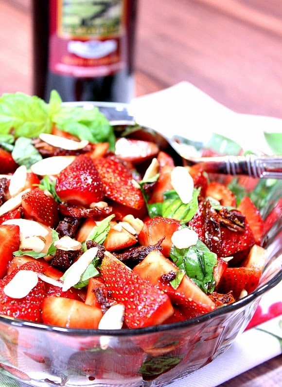 Strawberry, Sun-Dried Tomato and Basil Salad Recipe. Sweet strawberries and tart sun-dried tomatoes mingle nicely with fresh basil leaves. They're then dressed with a light and tasty balsamic vanilla vinegar and topped with almond slices.