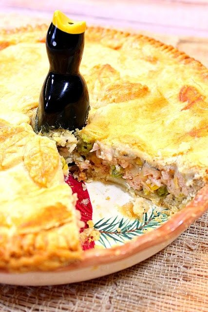 Homestyle Pork Pot Pie goes together quickly with the use of store-bought pie dough and leftover pork. Comfort food for all! - kudoskitchenbyrenee.com