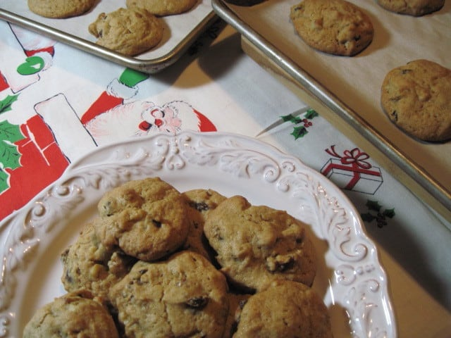 Retro feel photo of a plate of vintage rocks cookies on a Christmas tablecloth.
