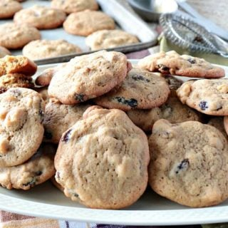 Vintage Rocks Cookies on a platter with a cookie sheet and cookies in the background
