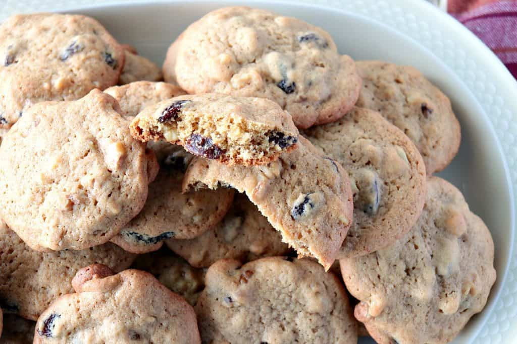 Overhead photo of a broken rocks cookie with raisins and walnuts.