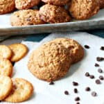 A couple of Butterscotch Ritz Cookies on a white napkin along with some Ritz cracker and some chocolate chips.