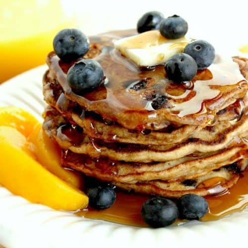 "This recipe for Blueberry Peach Pancakes is one I found (and adapted) from a Cooking Light cookbook called ""Lighten Up America.""  We loved this recipe, and you will too, but you don't have to tell your family they're healthy. That can be our little secret! - kudoskitchenbyrenee.com"