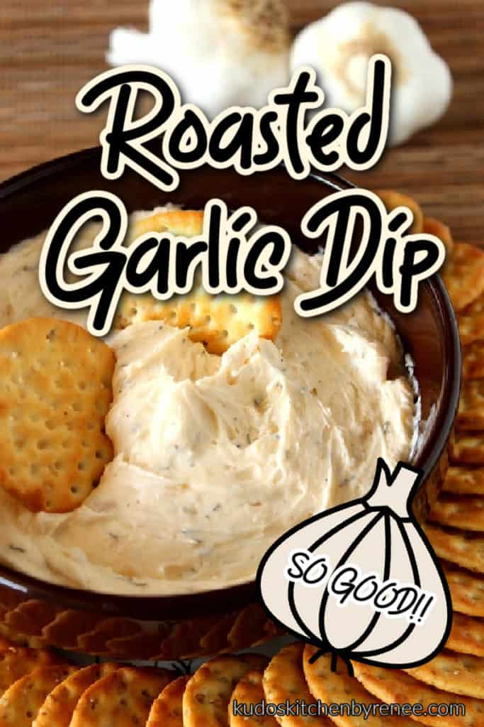 A vertical closeup image of roasted garlic dip in a round bowl with crackers and a title text overlay image with a cute garlic graphic