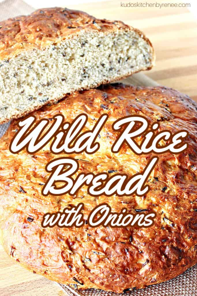 A vertical closeup of a golden brown round loaf of Wild Rice Bread with Onions and a title text overlay graphic in the center.