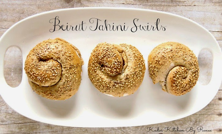 Overhead picture of Three Beirut Tahini Swirl buns on a white platter