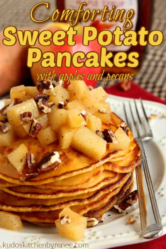 Closeup photo of a stack of sweet potato pancakes topped with apples and pecans and a sweet potato and apple in the background.