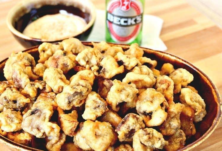 A bowl of beer battered fried mushrooms.