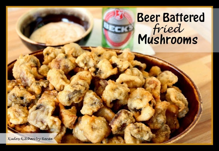 Fried mushrooms in a brown oval with with a bottle of beer in the background.