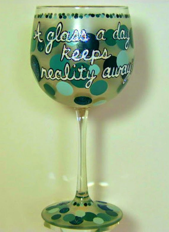 A glass a day keeps reality away painted wine glass.