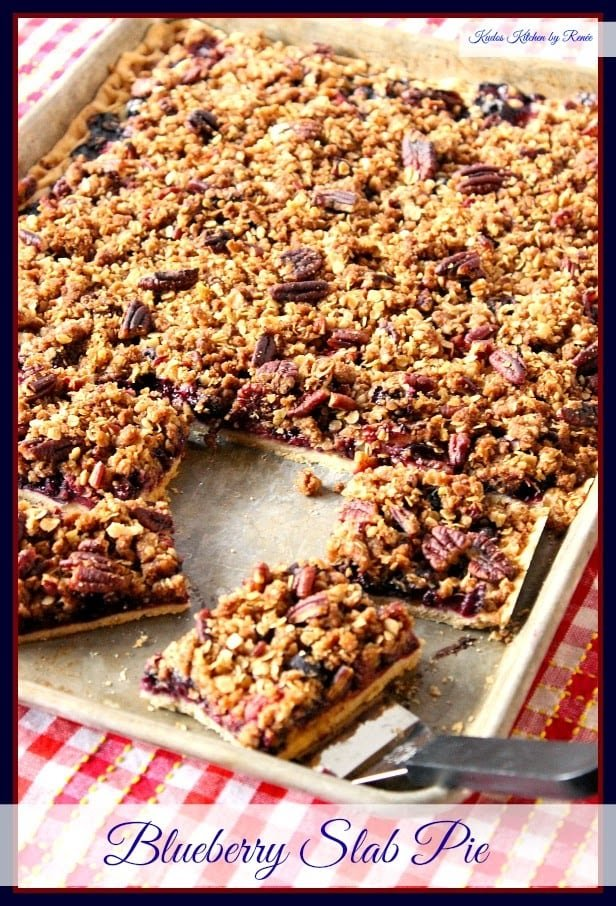 Blueberry Slab Pie has a crumble topping, is packed with fresh blueberries and has a light and flaky pie crust bottom.