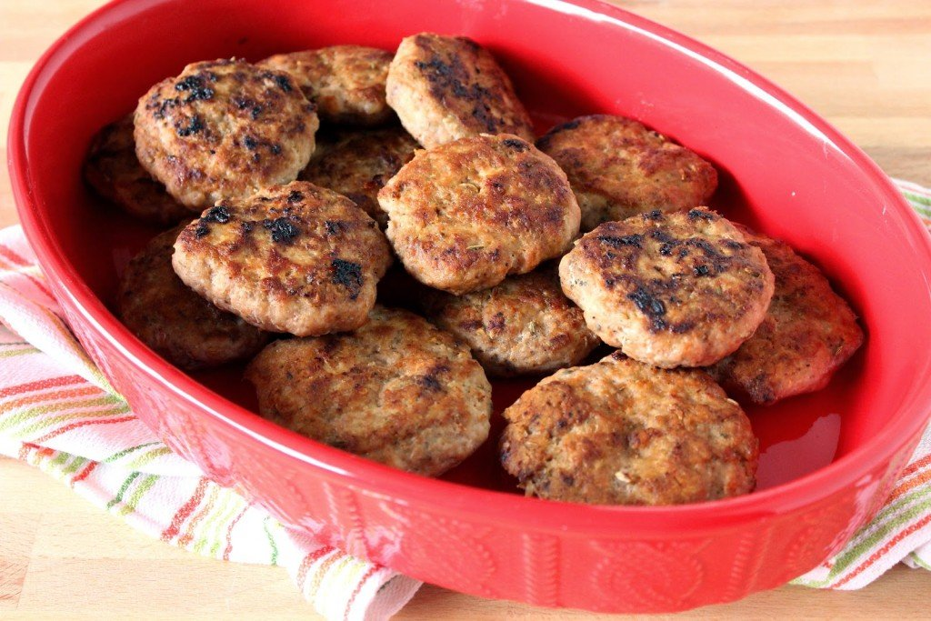 Homemade Turkey Breakfast Sausages in a oval red casserole dish.
