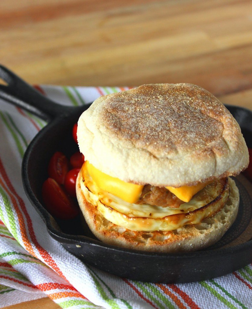 A vertical homemade egg muffin sandwich with Turkey Breakfast Sausage and cheese.