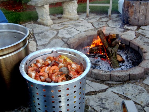 A huge pot of low country boil and a firepit.