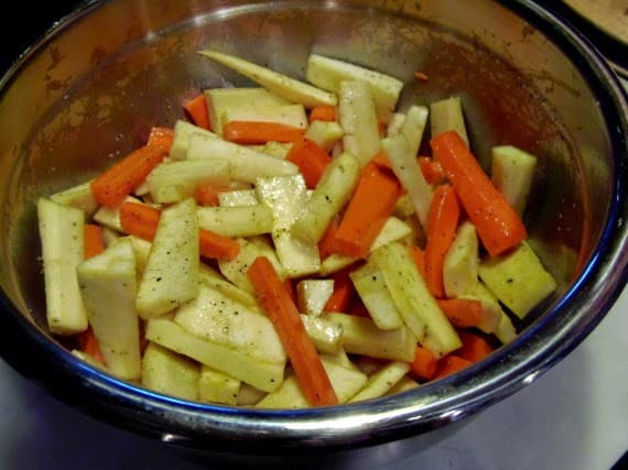 How to make roasted parsnips & carrots with cardamom and maple syrup.
