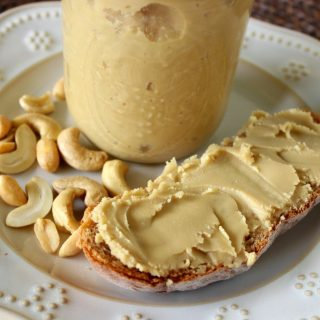 a slice of bread with homemade honey cashew butter spread on it