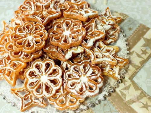 Fried Rosette Snowflake Cookies Recipe with Confectioners Sugar Dusting