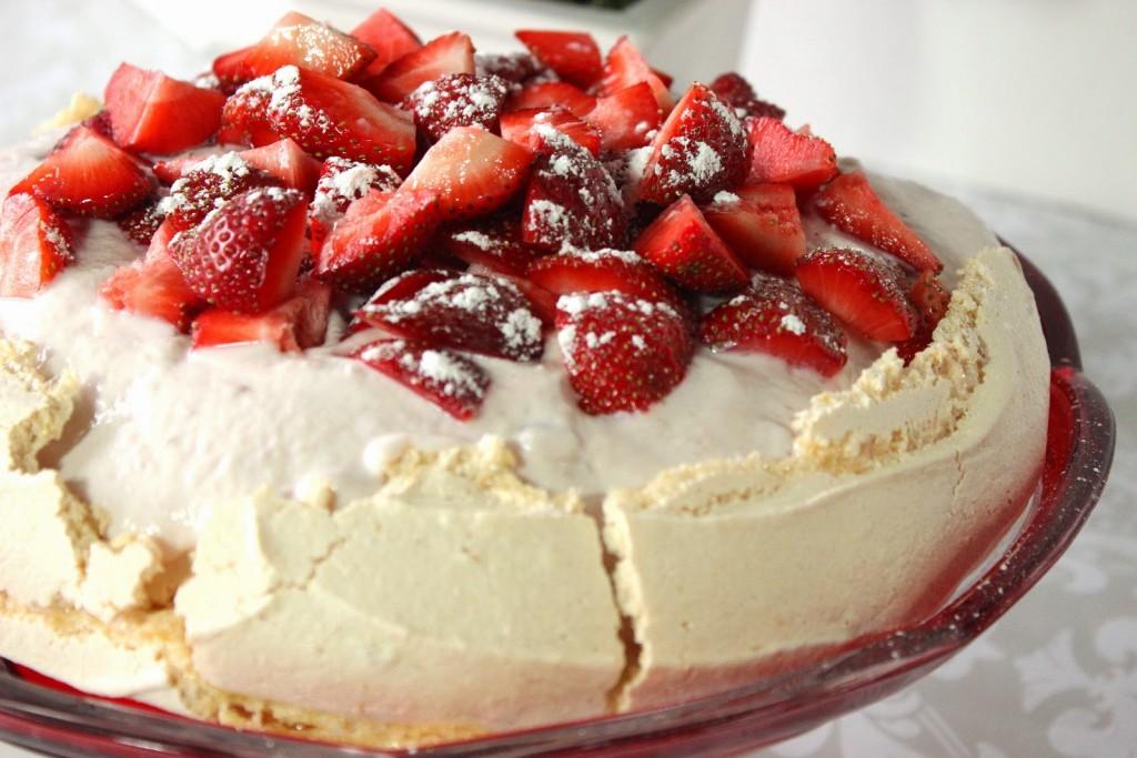 Fat-free Pavlova is crisp, light and topped with Chobani Greek yogurt and fresh strawberries.