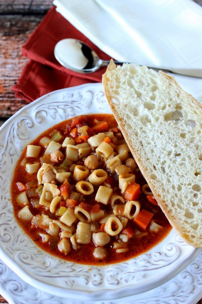 Tuscan Pasta Soup is rich and hearty with no meat but plenty of protein.   Kudos Kitchen by Renee