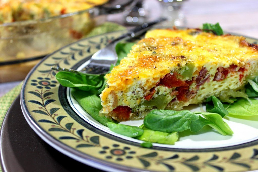 "Roasted spaghetti squash is pressed into a pie plate and baked. The ""crust"" is then filled with veggies, eggs and cheese and baked again."