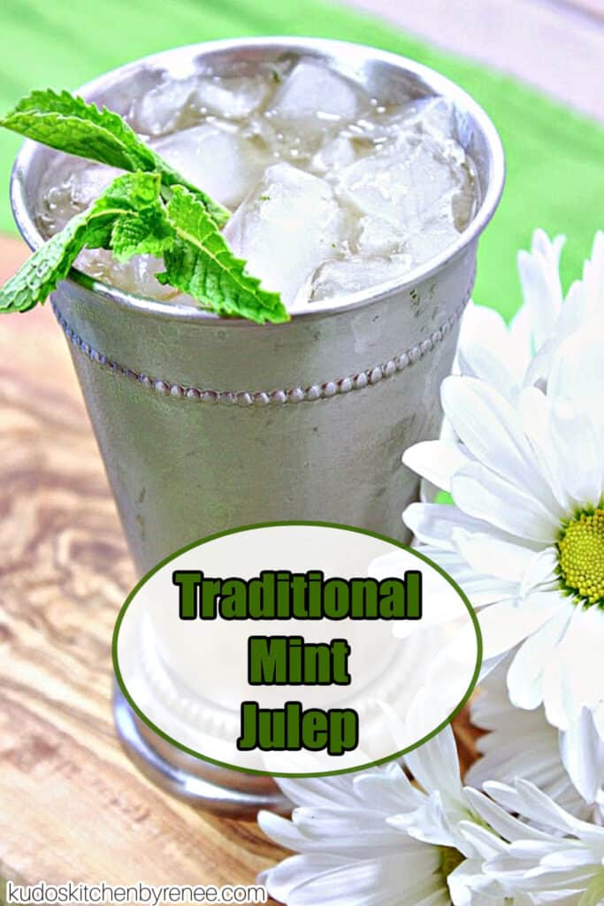 A vertical closeup of a Traditional Mint Julep along with white daisies and fresh mint.