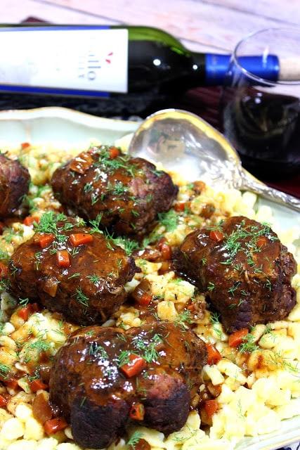 German Beef Rouladen with a wine bottle - kudoskitchenbyrenee.com