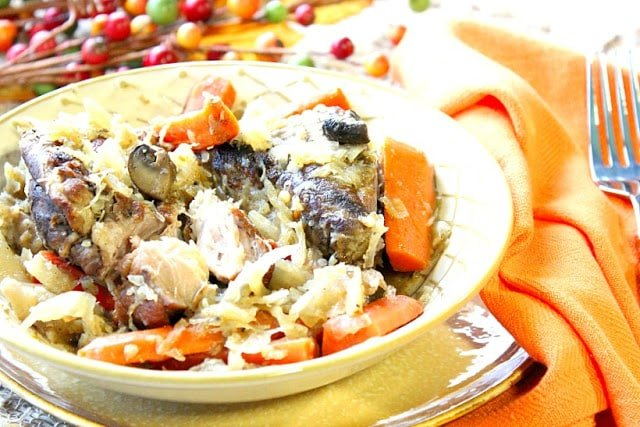 German Pork Ribs with Sauerkraut in a bowl with carrots and mushrooms