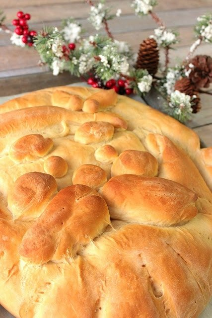 The recipe I'm sharing here is a good one. However, if you're interested in making a Shaped Santa bread, but don't want to go to the trouble of making your own dough, by all means, you can buy some store-bought frozen dough and follow the thawing and rising directions on the package. Then proceed from that point using the steps I'm sharing for assembling this adorable Shaped Santa Bread. - kudoskitchenbyrenee.com