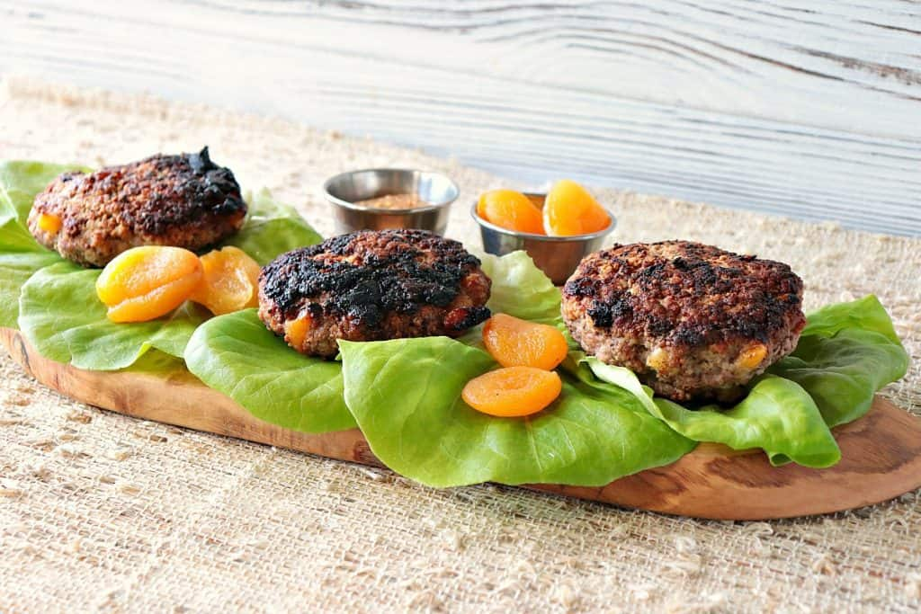 Three pork burgers with dried apricots and lettuce leaves. - kudoskitchenbyrenee.com