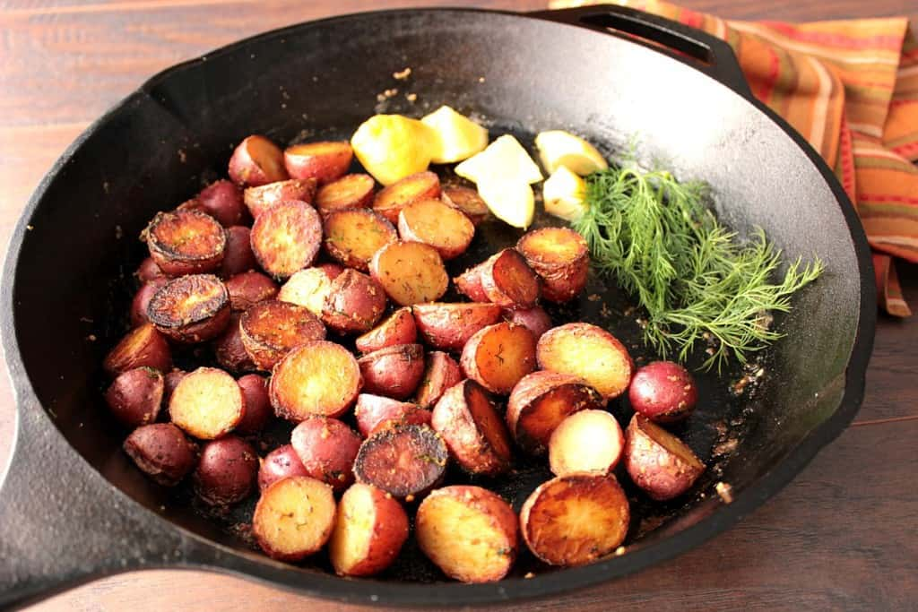 Crispy Red Potatoes with Lemon and Dill in a large cast iron skillet