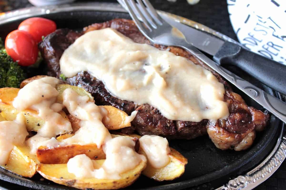Bourbon Butter Sauce over steak and potatoes