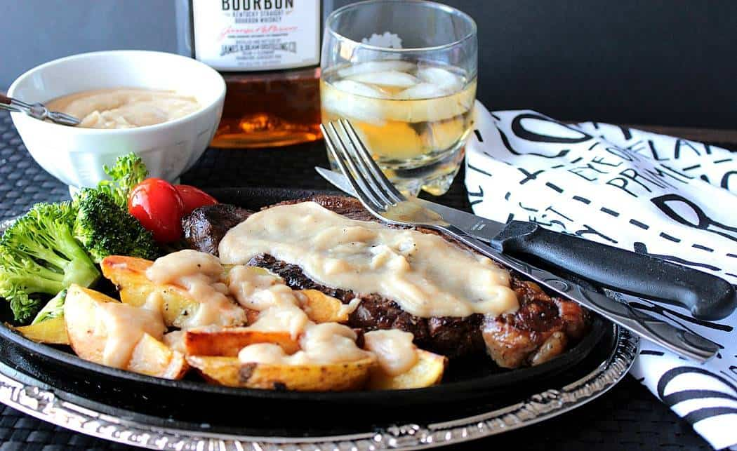 Steak and Roasted Potatoes with Bourbon Butter Sauce is a manly meal that woman will go crazy for too.