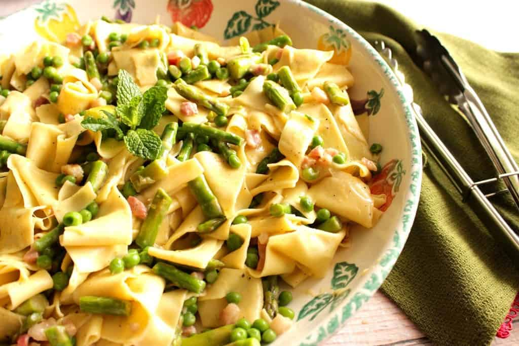 The fresh flavors of spring burst forth in this easy to make dish of Pappardelle with Peas, Asparagus and Mint.