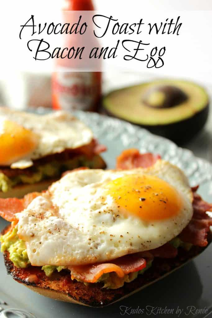 Sunny side up egg on top of Avocado Toast with Bacon