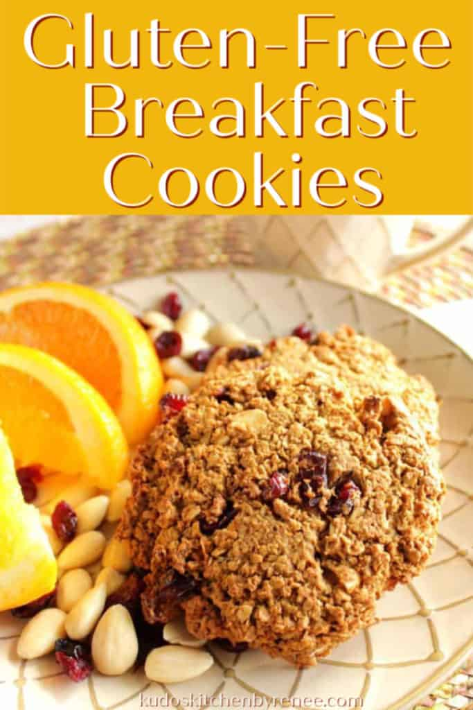 Vertical title text image of gluten-free cookies on a plate with oranges, almonds, and cranberries.