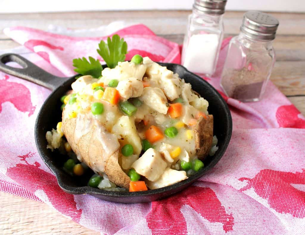 Chicken Pot Potato in a skillet with a creamy and vegetables.