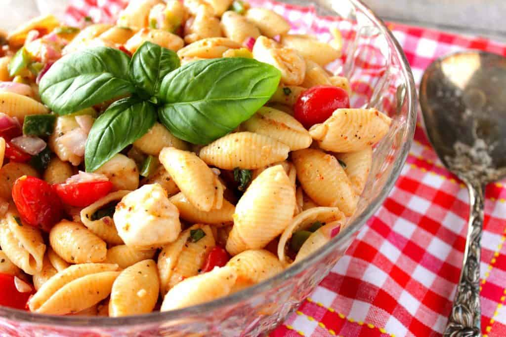 Italian Shell Pasta Salad with Basil and Mozzarella in a glass bowl