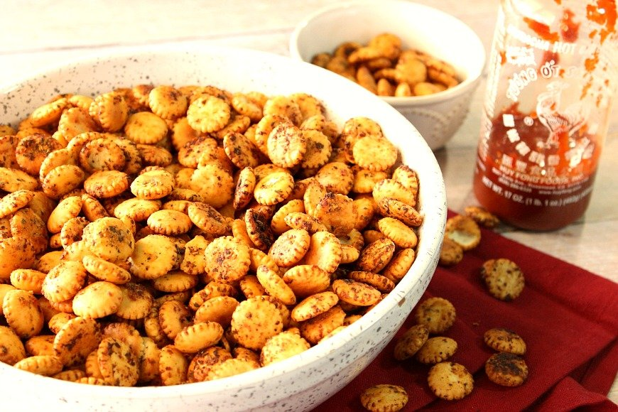 Horizontal photo of a bowl filled with Sriracha firecracker snackers. Thanksgiving and fall appetizer recipe roundup.