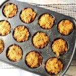 Overhead photo of muffin tin crab cakes in a muffin tin and on a wire rack.
