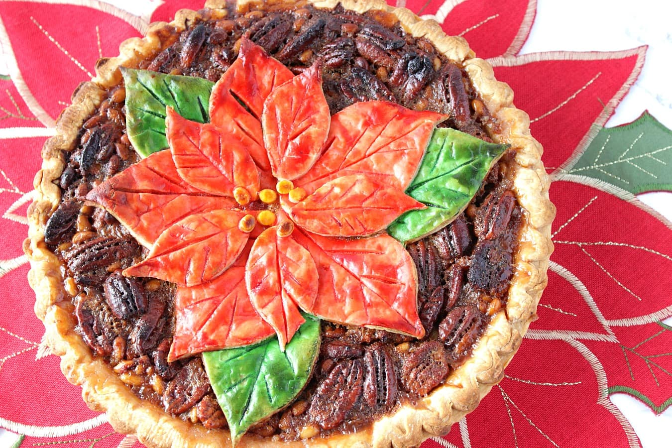 Bourbon Pecan Pie with Painted Pointsettia Crust