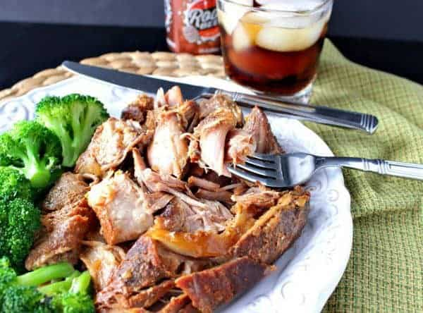 Slow Cooker Root Beer Country Ribs on a white plate with broccoli.