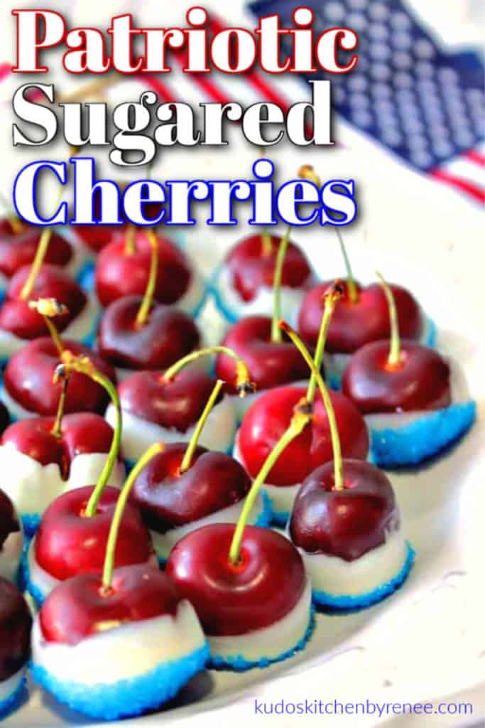 A closeup vertical image of red white and blue sugared cherries on a white platter with title text overlay graphics