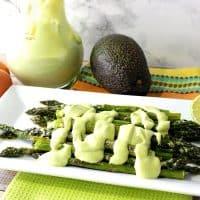 Creamy Avocado Hollandaise Sauce Over Oven Roasted Asparagus