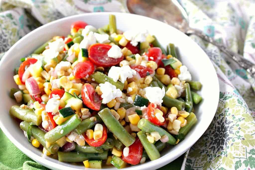 Farmer's market veggie salad with green beans, tomatoes, corn, and goat cheese.